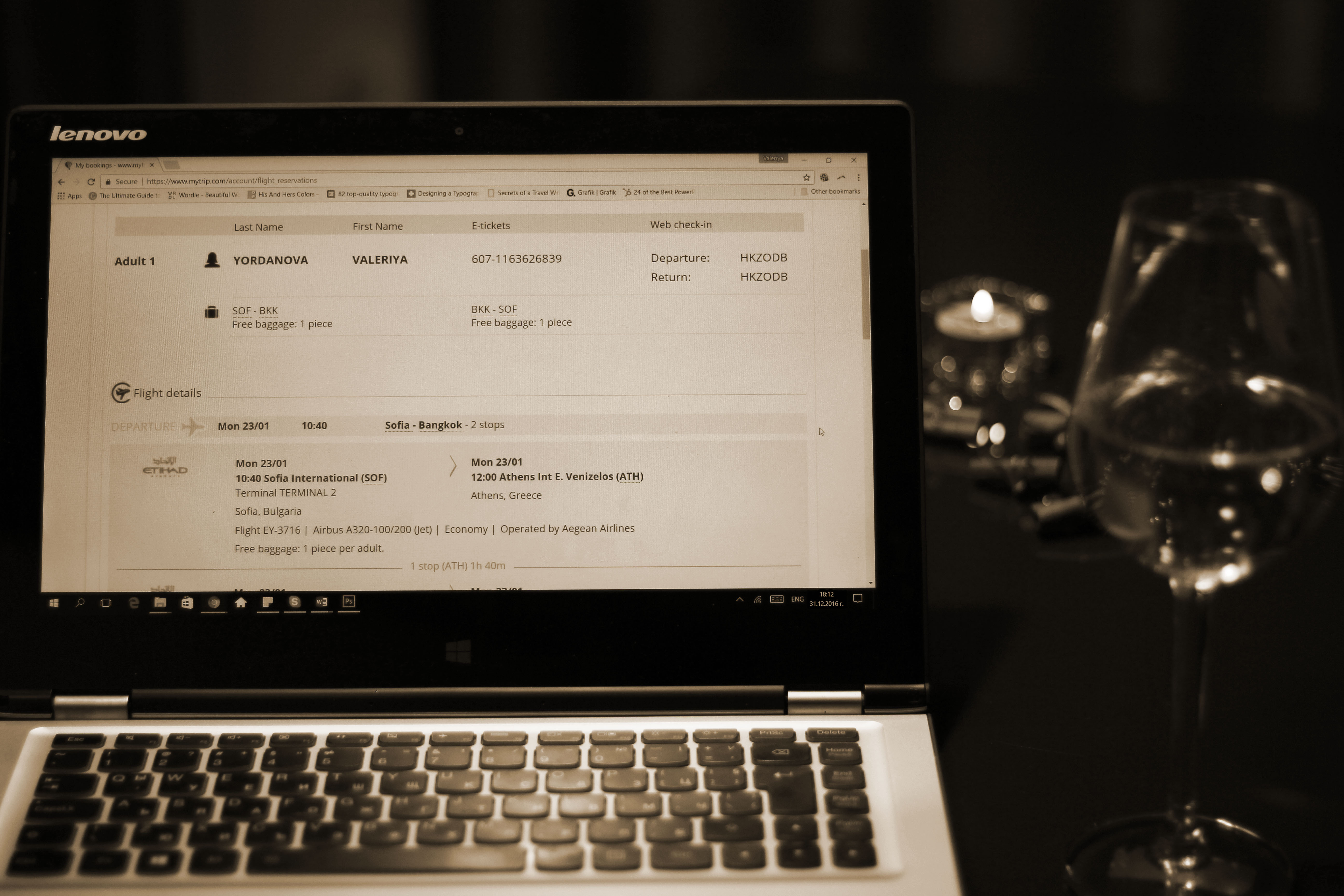 Online solo flight ticket and a glass of wine